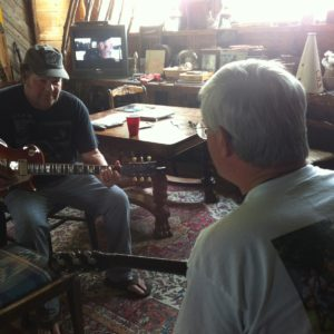 Musician Dave Widow instructs student at the Crossroads.