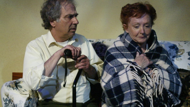 Dennis Hattem comforts Mary-Margaret Lewis in The Gin Game. Photo by Mickey Elliot.