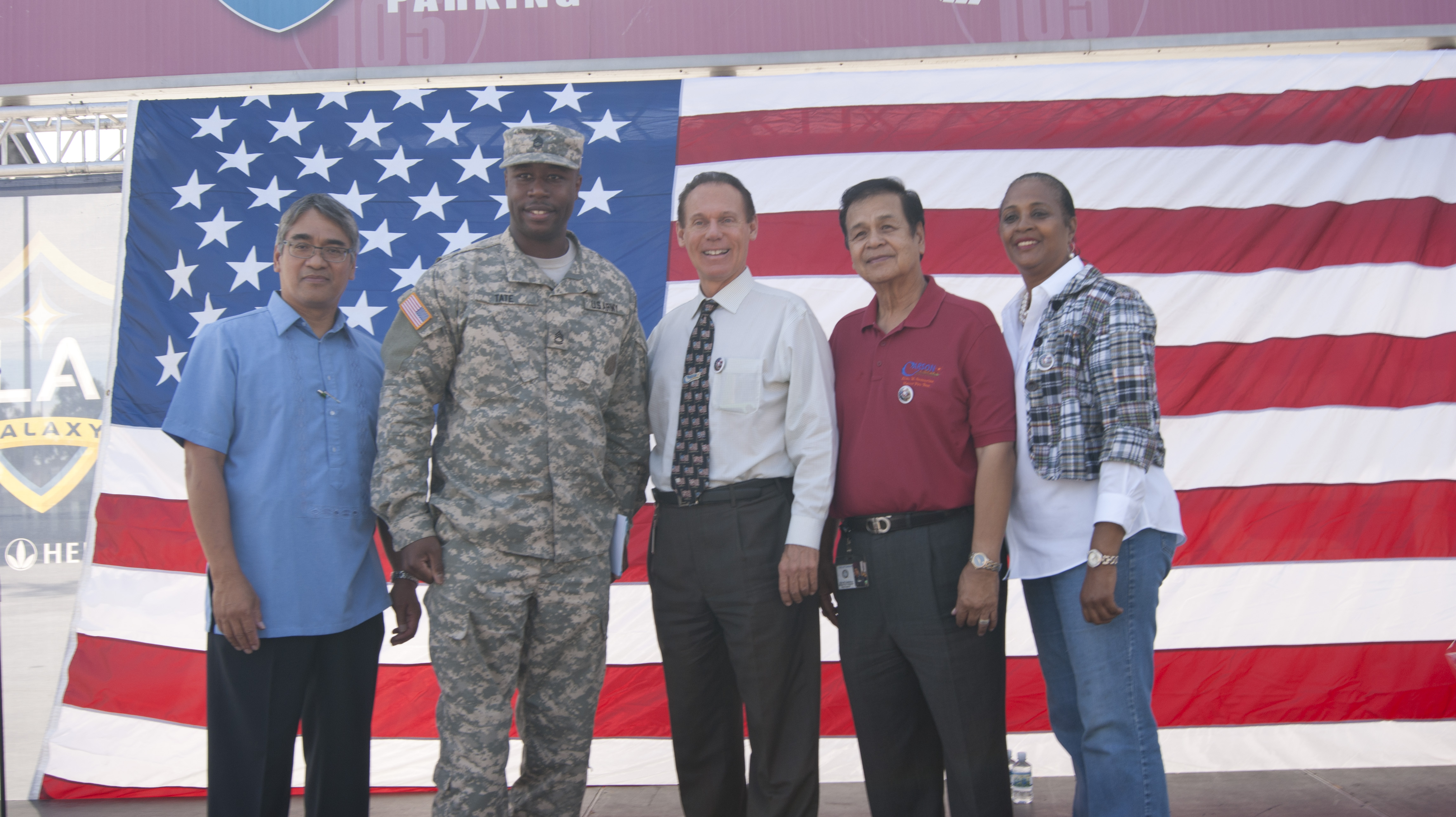 Carson Planning Commissioner Charlotte Brimmer, Councilman Elito Santarino, Carson Mayor Jim Dear, U.S. Army officer Tate.