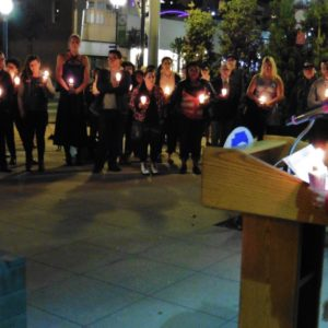 Christina Bennett reads the names and details of some of the murders of transgender people at the Transgender Remembrance Day ceremony t the Memorial Service at Harvey Milk Park in Long Beach. Photos by Diana Lejins.