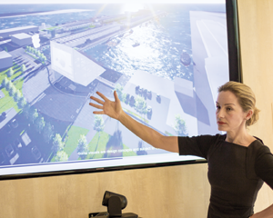 AltaSea Executive Director Rachel Etherington shows a projection of the future Marine Science campus. Photo by Phillip Cooke