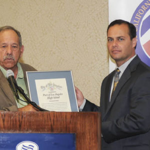 On May 6, Harbor Commissioner Dave Arian Presented a plaque of recognition to Port of Los Angeles High School Principal Tom Scotti. Photo by Erin Loveridge. Courtesy of POLAHS