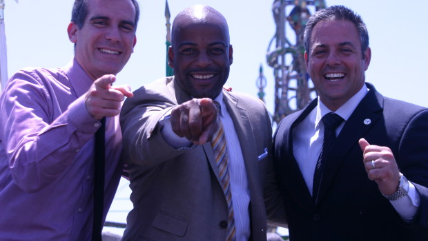 Sen. Isadore Hall with Mayor Eric Garcetti with Councilman Joe Buscaino during the councilman's July 2013 inauguration ceremony in Watts.