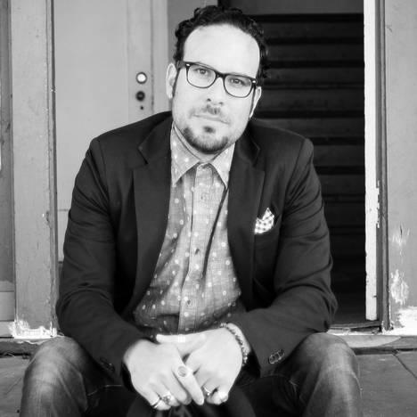 Mike De la Rocha, founder and director of Revolve Impact.