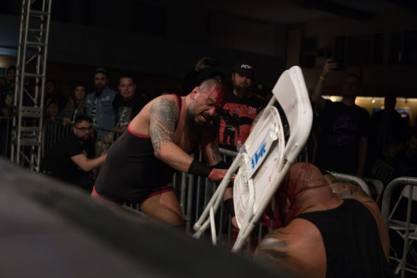 Josepfh Samael (Cabibbo) swings a folding chair at Danny Maff during Wrestle Summit. Photo provided by PCW ULTRA.